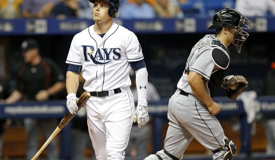 Tampa Bay Rays' Brandon Guyer reacts after striking out to end the ninth inning as Miami Marlins catcher J.T. Realmuto celebrates during a baseball game Wednesday, May 25, 2016, in St. Petersburg, Fla. The Marlins won 4-3. (AP Photo/Mike Carlson)