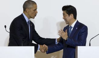 President Barack Obama and Japanese Prime Minister Shinzo Abe shake hands after speaking to media in Shima, Japan, Wednesday, May 25, 2016. (AP Photo/Carolyn Kaster)