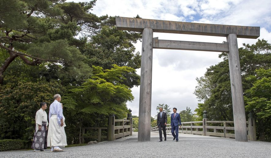 U.S. President Barack Obama and Japan Prime Minister Shinzo Abe walk across the Ujibashi bridge as they visit the Ise Jingu shrine in Ise, Mie prefecture, Japan Thursday, May 26, 2016, ahead of the first session of the G7 summit meetings. The leaders of the G-7 nations have arrived for a visit at Ise Jingu, the most hallowed site for Japan's indigenous Shinto religion. (Doug Mills/Pool Photo via AP)