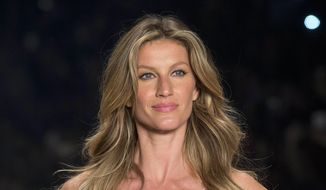 In this April 15, 2015, file photo, Brazilian supermodel Gisele Bundchen wears a creation from the Colcci Summer collection at Sao Paulo Fashion Week in Sao Paulo, Brazil. (AP Photo/Andre Penner, File)