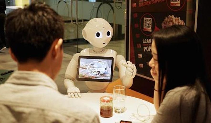 """Pizza Hut and MasterCard have teamed up to deploy Softbank's humanoid robot """"Pepper"""" in select restaurants in Asia by the end of the year. (MasterCard)"""