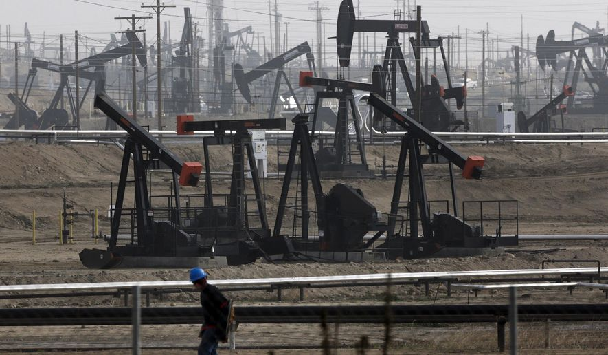 FILE - This Jan. 16, 2015 file photo shows pumpjacks operating at the Kern River Oil Field in Bakersfield, Calif. The price of oil topped $50 a barrel this week for the first time since July, delivering a cash infusion to oil producers and a lift to beaten-down energy stocks. (AP Photo/Jae C. Hong, File)