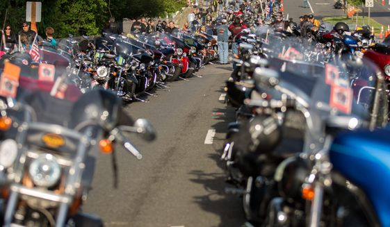 Hundreds of bikes line Route 50 outside of the Patriot Harley-Davidson in Fairfax as volunteers and riders prepare for the annual Ride of the Patriots in support of Rolling Thunder.