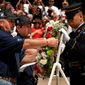 Veterans join the tomb guard to place a wreath at The Tomb of the Unknowns at Arlington National Cemetery as part of a Run to the Wall event. (Washington Times photographs)