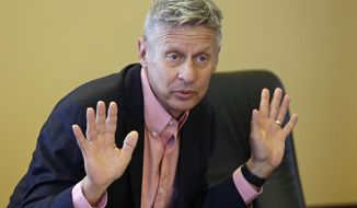 "In this May 18, 2016 file photo, Libertarian presidential candidate, former New Mexico Gov. Gary Johnson speak with legislators at the Utah State Capitol in Salt Lake City. He has virtually no money, no strategy to compete in battleground states and no plan to stop talking about his drug use. Yet with the Republican Party facing the prospect of a Donald Trump presidency, Libertarian presidential hopeful Gary Johnson could be a factor in 2016. The former two-term New Mexico governor, a Republican businessman perhaps best known for his years-long push to legalize marijuana, has a sobering message for a ""never-Trump"" movement desperately seeking a viable alternative. (AP Photo/Rick Bowmer, File)"