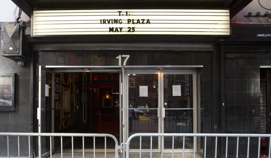 The Irving Plaza marquee is shown, Thursday, May 26, 2013 in New York.  Shots rang out inside the concert venue Wednesday night, where hip-hop artist T.I. was getting ready to perform.  (AP Photo/Mark Lennihan)