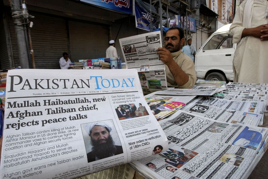 """Pakistani news papers carry headlines about a news Taliban leader, are display at a news stand in Peshawar, Pakistan, Thursday, May 26, 2016. Pakistan's foreign affairs adviser to prime minister Sartaj Aziz said Thursday that """"all indicators"""" confirmed that the former Taliban chief Mullah Akhtar Mansour was killed in a U.S. drone strike in the country's southwestern Baluchistan province, where he was travelling under a false name with fake Pakistani identity documents. (AP Photo/Mohammad Sajjad)"""