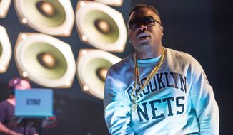 Troy Ave performs at Christmas in Brooklyn at the Barclays Center on Dec. 19, 2014. (Associated Press)
