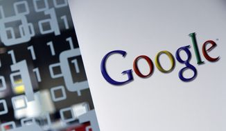 This March 23, 2010, file photo shows the Google logo at the Google headquarters in Brussels. (AP Photo/Virginia Mayo, File)