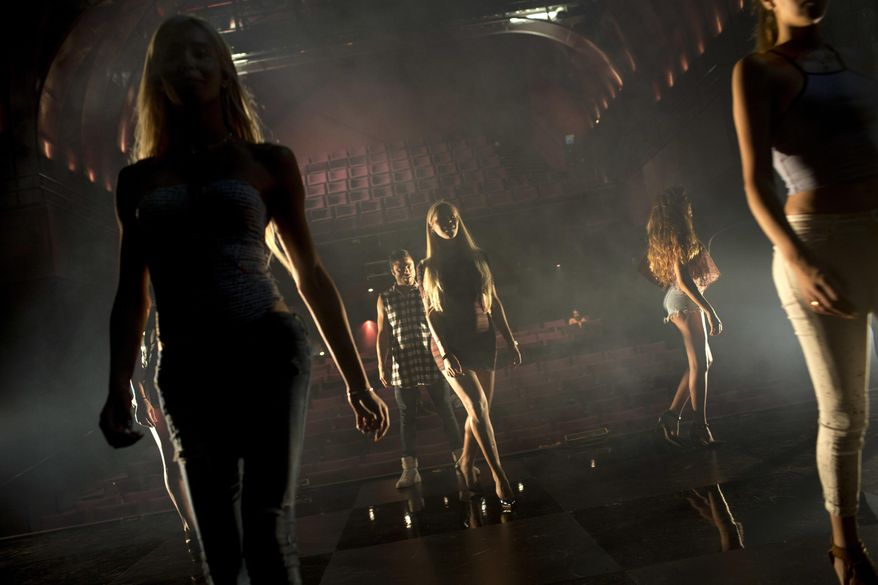 Contestants in the first Miss Trans Israel beauty pageant practice the walk on the stage during rehearsal in Tel Aviv, Israel, Thursday, May 26, 2016. The pageant will be held at HaBima, Israel's national theater, in Tel Aviv on Friday. Tel Aviv has emerged as one of the world's most gay-friendly travel destinations, standing in sharp contrast to most of the rest of the Middle East, where gays can face persecution. (AP Photo/Oded Balilty)