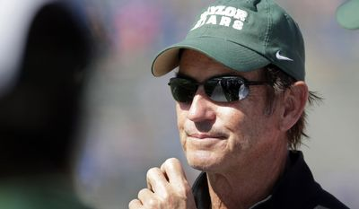 """FILE - In this Oct. 10, 2015, file photo, Baylor head coach Art Briles watches during the second half of an NCAA college football game against Kansas in Lawrence, Kan. Baylor University's board of regents says it will fire Briles and re-assign university President Kenneth Starr in response to questions about its handling of sexual assault complaints against players.  The university said in a statement Thursday, May 26, 2016, that it had suspended Briles """"with intent to terminate.""""  Starr will leave the position of president on May 31, but the school says he will serve as chancellor. (AP Photo/Charlie Riedel, File)"""