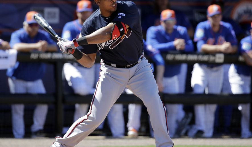 FILE - In this March 6, 2016, file photo, Atlanta Braves' Hector Olivera bats during a spring training baseball game against the New York Mets in Port St. Lucie, Fla. Olivera was suspended through Aug. 1 for his arrest on domestic violence charges. The suspension, announced Thursday, May 26, by commissioner Rob Manfred, is without pay and covers 82 games, retroactive to April 30. (AP Photo/Jeff Roberson, File)