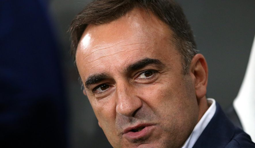 FILE - This is a Wednesday, Sept. 23, 2015 file photo of Sheffield Wednesday's manager Carlos Carvalhal as he awaits the start of the English League Cup third round soccer match between Newcastle United and Sheffield Wednesday at St James' Park, Newcastle, England.  Sheffield Wednesday will play Hull City against  in the Premier League play-off final at Wembley on Saturday May 28, 2016. The winner of the match will be promoted to the English Premier League next season.(AP Photo/Scott Heppell, File)