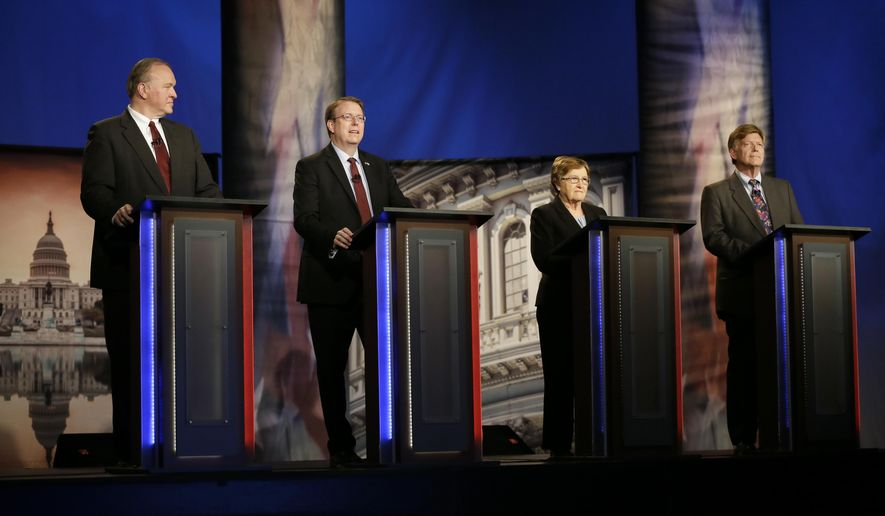 Iowa Democratic candidates for U.S. Senate, from left, attorney Tom Fiegen, State Sen. Rob Hogg, D-Cedar Rapids, former Lt. Gov. Patty Judge and former state legislator Bob Krause stand on stage before a debate Thursday, May 26, 2016, in Johnston, Iowa. (AP Photo/Charlie Neibergall)