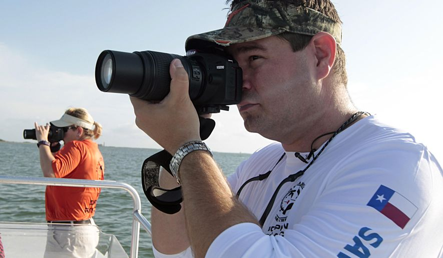 Texas Sealife Research Director of Research Will McGlaun right, and volunteer Sara Callender left, take photographs during a dolphin survey Tuesday, May 17, 2016, in Port Aransas, Texas.  The Marine Mammal Protection Act, as amended in 1994, requires the National Marine Fisheries Service to study and report on dolphin species, population estimates, reproductive rates, major threats and other trends. But when scientists, government officials and congressmen focused on the effects of the Deepwater Horizon spill, it became clear that the underfunded fisheries service hadn't done its job over the years and was depending on outdated data, much of it at least 10 years old.    (James Nielsen/Houston Chronicle via AP) MANDATORY CREDIT