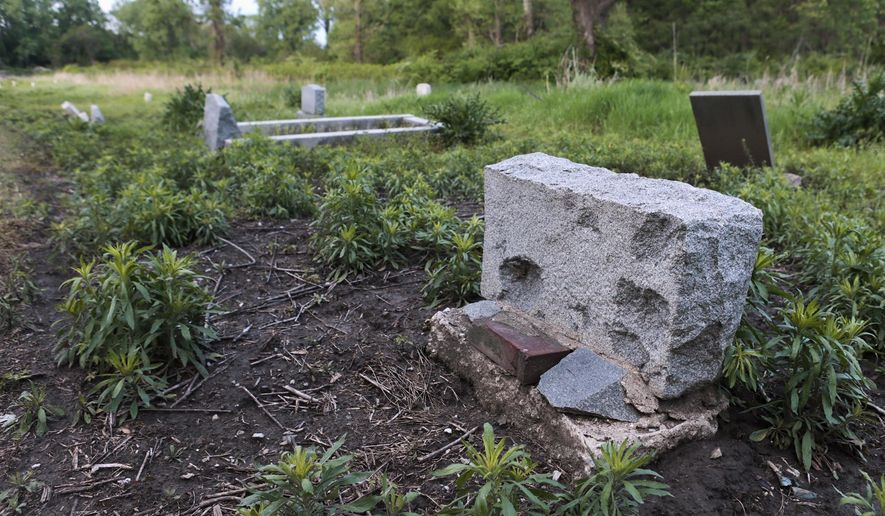 ADVANCE FOR USE SUNDAY, MAY 29 AND THEREAFTER - In this April 29, 2016, photo, headstones are seen at Booker T. Washington Cemetery in rural Centreville, Ill. The cemetery has become overgrown with weeds and many of the headstones have been damaged by vandalism. Judy Jennings of the St. Clair County Genealogical Society has been researching the cemetery, mainly to help people find their ancestors. (Zia Nazami/Belleville News-Democrat via AP) MANDATORY CREDIT