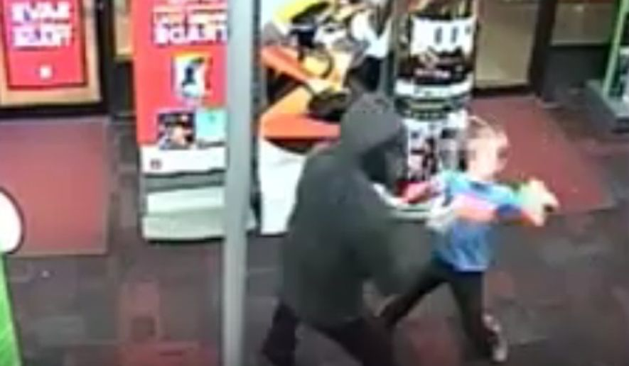 A 7-year-old boy is being hailed for his act of bravery after he fought back against armed robbers at a Maryland GameStop last week. (YouTube/@mcpdmedia)