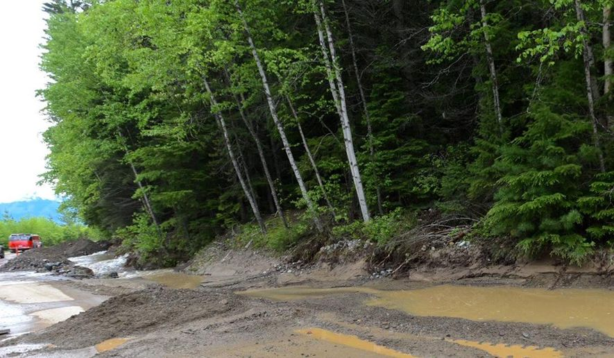 Traffic on the popular Going-to-the-Sun Road near Apgar Campground in Glacier National Park, Mont., is diverted because of a mudslide to one lane Wednesday, May 25, 2016. Park officials say beavers are to blame for the third straight day the road has been closed due to a mudslide, dragging trees and debris into the street. (Tommy Martino/The Missoulian via AP) MANDATORY CREDIT