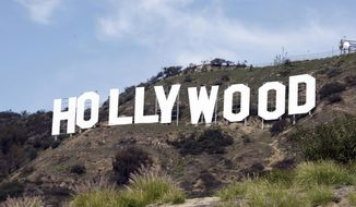 This file photo taken Friday Jan. 29, 2010, shows the Hollywood sign near the top of Beachwood Canyon adjacent to Griffith Park in the Hollywood Hills of Los Angeles. (AP Photo/Reed Saxon, File)