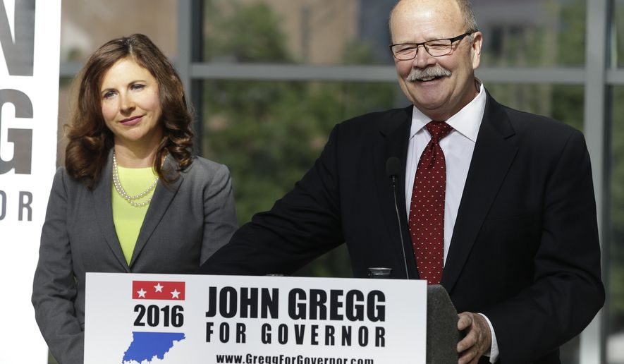 Democratic Indiana gubernatorial candidate John Gregg and Indianapolis state Rep. Christina Hale listen to a question during a news conference, Wednesday, May 25, 2016, in Indianapolis. Gregg announced that Hale will be his running mate. (AP Photo/Darron Cummings)