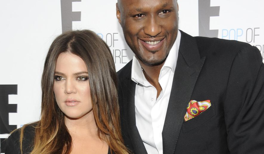 "FILE - In this April 30, 2012, file photo, Khloe Kardashian Odom and Lamar Odom from the show ""Keeping Up With The Kardashians"" attend an E! Network upfront in New York. Kardashian filed for divorce from Odom for the second time on Thursday, May 26, 2016, citing irreconcilable differences. The pair married in September 2009 and broke up in late 2013, but Kardashian withdrew her first divorce petition after Odom was found unconscious at a Nevada brothel last year and required serious medical treatment. (AP Photo/Evan Agostini, File)"