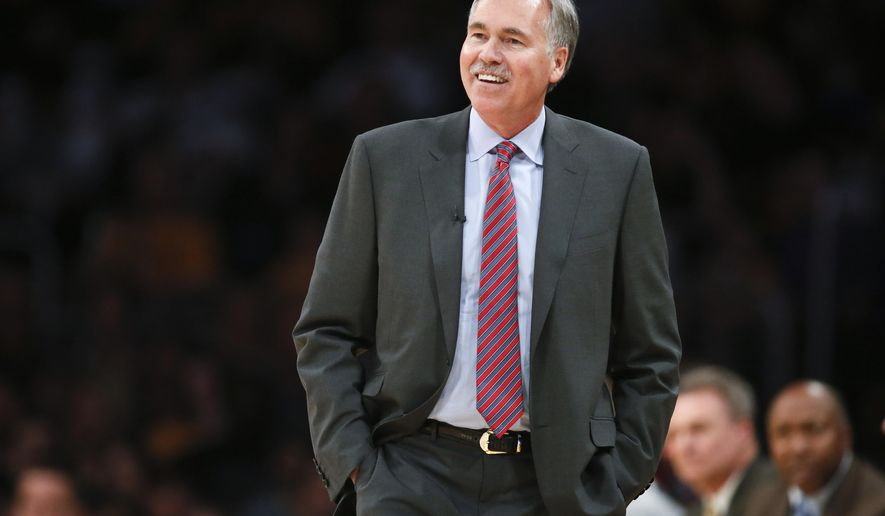 """FILE - In this March 9, 2014, file photo, then-Los Angeles Lakers coach Mike D'Antoni walks the sideline during the NBA basketball team's gane against the Oklahoma City Thunder in Los Angeles. D'Antoni is headed to Houston to try his """"Seven Seconds or Less"""" offense with James Harden, one of the NBA's most explosive offensive threats. D'Antoni reached agreement with the Rockets on a four-year deal on Thursday, May 26, 2016, a person with knowledge of the situation told The Associated Press. The person spoke on condition of anonymity because the team has not announced the hiring, which was first reported by Yahoo! Sports. (AP Photo/Danny Moloshok, File)"""