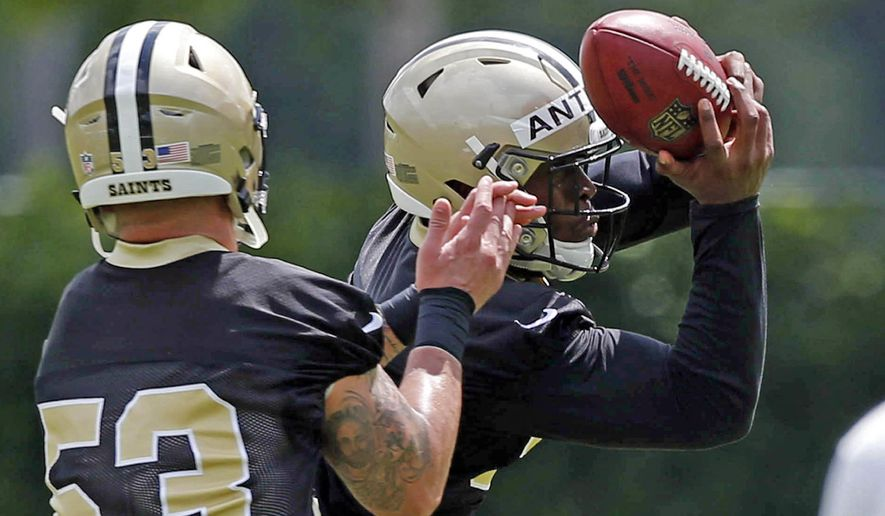 New Orleans Saints linebacker Stephone Anthony, right, goes through drills against linebacker James Laurinaitis (53) during NFL football practice in Metairie, La., Thursday, May 26, 2016. Anthony, a 2015 first-round pick who quickly took over as starting middle linebacker, is preparing for a position change. New Orleans plans to have free-agent acquisition James Laurinaitis take over that spot and the defensive play-calling and alignment responsibilities that go with it. (AP Photo/Gerald Herbert)