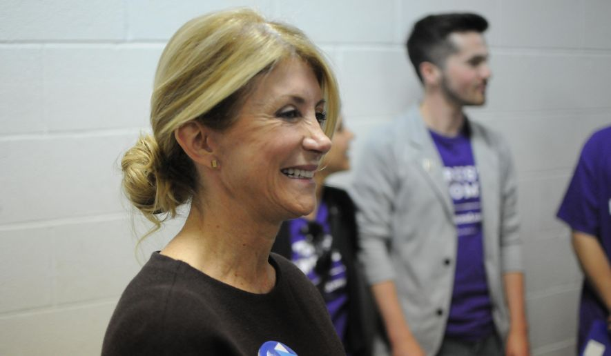 Former Texas state Sen. Wendy Davis speaks in support of then-Democratic presidential hopeful Hillary Clinton to South Dakotans as the candidate who would look out for women to the benefit of the nation's economy, Thursday, May 26, 2016, at the opening of Clinton's first South Dakota office. (AP Photo/James Nord) ** FILE **
