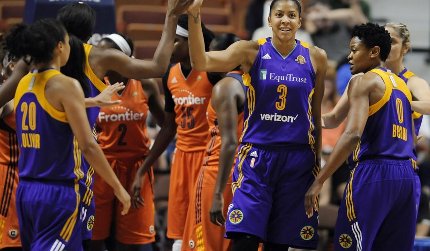 Los Angeles Sparks' Candace Parker, high-fives Nneka Ogwumike,second from left, during the first half of a WNBA basketball game against the Connecticut Sun, Thursday, May 26, 2016, in Uncasville, Conn. (AP Photo/Jessica Hill)