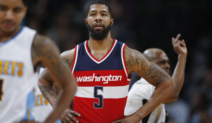 "FILE - In this March 12, 2016, file photo, Washington Wizards forward Markieff Morris (5) pauses during the team's NBA basketball game against the Colorado Nuggets, during a stoppage in play. A person familiar with the situation says Morris was detained at Philadelphia International Airport and then released. The person spoke to The Associated Press on condition of anonymity Thursday, May 26, 2016, because Morris was not charged. The person did not specify why Morris was detained. The Wizards said in a statement they ""spoke with Markieff earlier today and will continue to gather more details."" (AP Photo/David Zalubowski, File)"