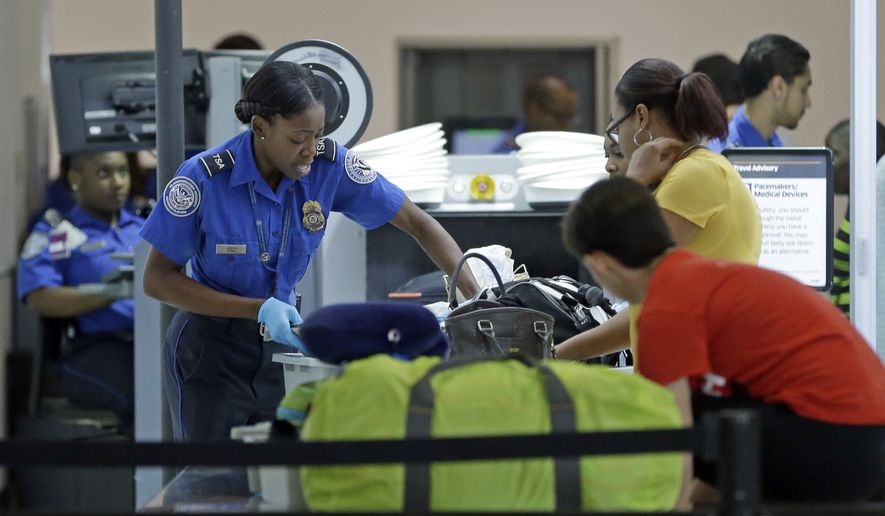 a transportation security administration officer checks travelers luggage to be screened by an x ray - Transportation Security Officer