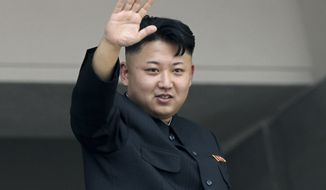 "In this July 27, 2013 photo, North Korea's leader Kim Jong Un waves to spectators and participants of a mass military parade celebrating the 60th anniversary of the Korean War armistice in Pyongyang, North Korea. President Barack Obama is ""recklessly"" spreading rumors of a Pyongyang-orchestrated cyberattack of Sony Pictures, North Korea says, as it warns of strikes against the White House, Pentagon and ""the whole U.S. mainland, that cesspool of terrorism."" (AP Photo/Wong Maye-E, File)"