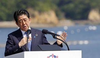 Japanese Prime Minister Shinzo Abe speaks at the G-7 summit in Shima, central Japan, Friday, May 27, 2016. (AP Photo/Shizuo Kambayashi)