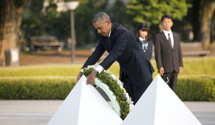 U.S. President Barack Obama lays a wreath at Hiroshima Peace Memorial Park in Hiroshima, western, Japan, Friday, May 27, 2016. Obama on Friday became the first sitting U.S. president to visit the site of the world's first atomic bomb attack, bringing global attention both to survivors and to his unfulfilled vision of a world without nuclear weapons. (AP Photo/Shuji Kajiyama)