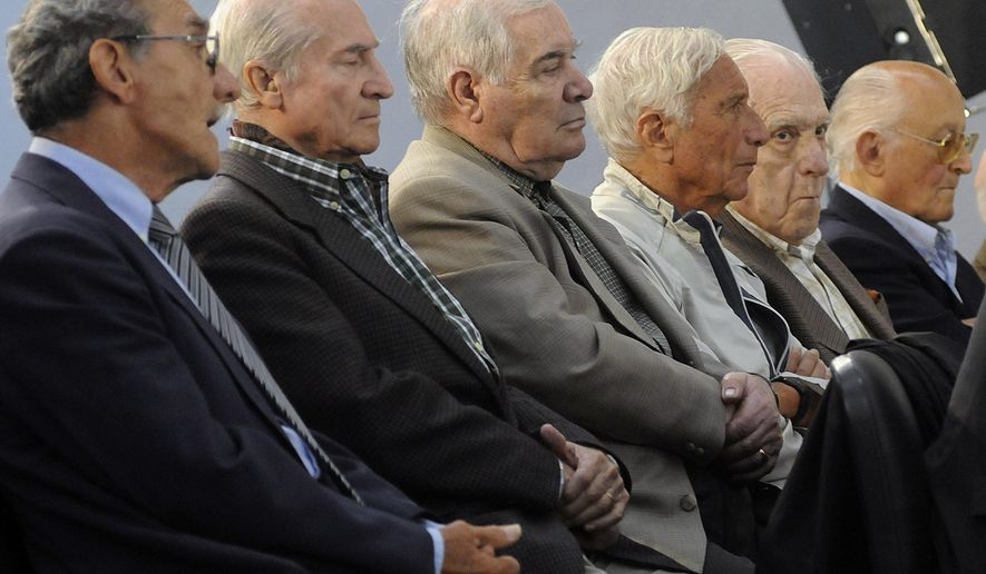 FILE - In this Nov. 2, 2009 file photo, former military, police and Argentina's last dictator attend the start of their trial in connection with human rights abuses during Argentina's dirty war in Buenos Aires. Argentina's last dictator and 14 other former military officials were sentenced to prison on Friday, May 27, 2016 for human rights crimes committed during the Operation Condor conspiracy to hunt down dissidents across the region. From left to right are former police officer German Montenegro, former army officers Jorge Osvaldo Garcia, Carlos Tepedino, Eugenio Guanabens, former and last dictator Gen. Reynaldo Bignone and former Gen. Omar Rivero. (AP Photo/Rolndo Andrade Stracuzzi, File)