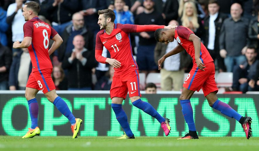 England's Marcus Rashford, right, celebrates his goal with teammates during the International friendly soccer match between England and Australia at the Stadium of Light, Sunderland, England, Friday, May 27, 2016. (AP Photo/Scott Heppell)