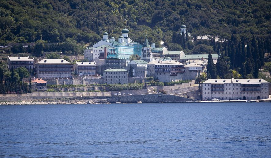 A view from the sea of the Russian monastery St. Panteleimon in Karyes, on Mount Athos, Greece, Friday, May 27, 2016. Russia's president is due in financially struggling Greece Friday for a state visit that will include a trip to a 1,000-year-old, all-male Orthodox Christian sanctuary in the north of the country. (AP Photo/Darko Bandic)