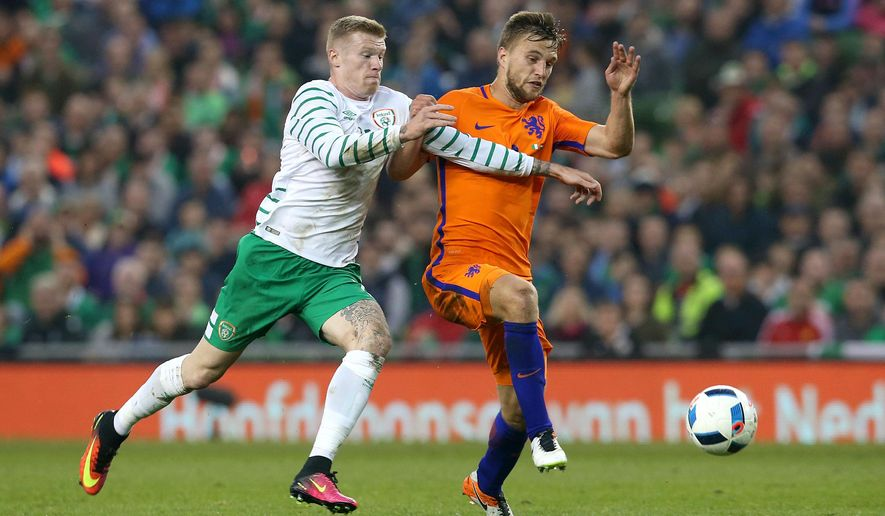 Republic of Ireland's James McLean, left, and Netherlands' Joel Veltman during the international friendly at the Aviva Stadium, Dublin, Ireland,  Friday May 27, 2016. (Brian Lawless/PA via AP)  UNITED KINGDOM OUT