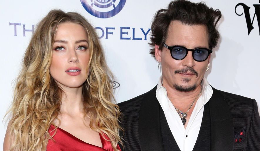 Amber Heard, left, and Johnny Depp arrive at The Art of Elysium's Ninth annual Heaven Gala at 3LABS, in Culver City, Calif., Jan. 9, 2016. (Photo by Rich Fury/Invision/AP, File) ** FILE **