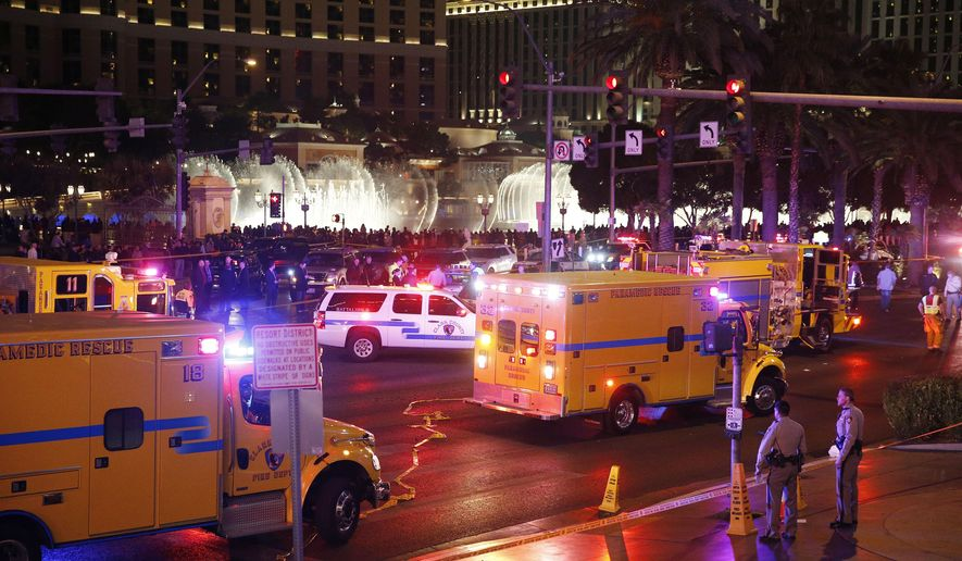 FILE - In this Dec. 20, 2015 file photo, police and emergency crews respond to the scene of an incident along Las Vegas Boulevard, in Las Vegas. Crime is spiking in Las Vegas and spurring questions about causes and cures. A motorist plowed through a crowd of Las Vegas Strip pedestrians in December, killing one and injuring at least 34 others from seven states, Mexico and Canada. (AP Photo/John Locher, File)