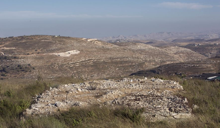 This Wednesday, May 18, 2016 photo shows rubble from a 2006 partial evacuation of Amona, an unauthorized Israeli settler outpost in the West Bank, east of the Palestinian town of Ramallah. It is the largest of about 100 outposts in the West Bank which were built without permission but generally tolerated by the government. Under an Israeli Supreme Court order, the government must tear down the outpost by the end of 2016. (AP Photo/Oded Balilty)