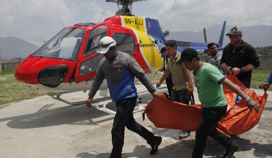 FILE- In his May 26, 2016, file photo, the body of a climber who died during a Mount Everest expedition, is carried to  hospital in Kathmandu, Nepal. Nearly 300 people have died on Mt. Everest in the century or so since climbers have been trying to reach the summit and at least 100 of them are still on the mountain. (AP Photo/Niranjan Shrestha, File)