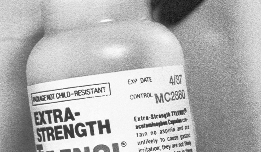 FILE - In this Sept. 30, 1982 file photo, a bottle of Extra-Strength Tylenol from the same lot, number MC 2880, found to have caused cyanide poisoning to people in the Chicago area is displayed in Chicago. About 35 years ago, Johnson & Johnson recalled more than 20 million bottles of Tylenol capsules after someone laced the painkillers with cyanide and put them in store shelves in the Chicago area. Seven people were killed. Johnson & Johnson repackaged Tylenol with tamper-resistant packaging. (AP Photo/File)