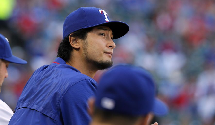 Texas Rangers' Yu Darvish watches play from the dugout during the first inning of the Rangers' baseball game against the Pittsburgh Pirates on Friday, May 27, 2016, in Arlington, Texas. (AP Photo/Tony Gutierrez)