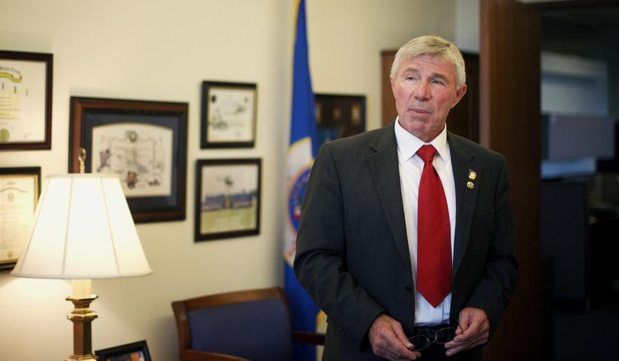 ADVANCE FOR USE MONDAY, MAY 30 AND THEREAFTER - In this May 24, 2016, photo, Republican state Rep. Bob Dettmer talks in his office in St. Paul, Minn., about a provision included in this year's supplemental budget bill that would exempt military retirement pay from Minnesota's income tax. Dettmer, a retired U.S. Army reserve warrant officer, has long been a champion of veteran's issues at the state Capitol. (AP Photo/Kevin Burbach)