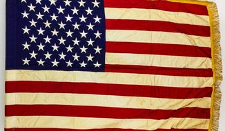 The last American combat flag used in the Vietnam War fetched $55,000 in a recent auction. (Alexander Historical Auctions)