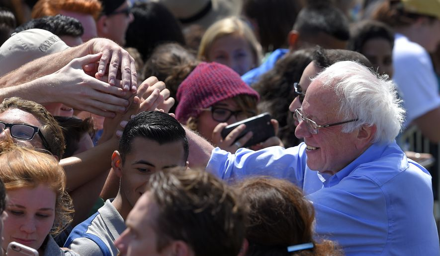 Democratic presidential candidate Sen. Bernie Sanders, right, I-Vt., greets supporters after speaking at a campaign rally, Saturday, May 28, 2016, in Santa Maria, Calif. (AP Photo/Mark J. Terrill)