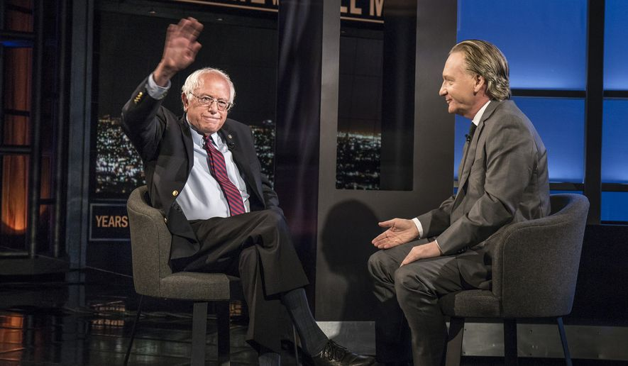 "In this photo provided by HBO, Democratic presidential candidate Sen. Bernie Sanders, I-Vt., left, speaks with host Bill Maher during an interview on the television show, ""Real Time With Bill Maher,"" Friday, May 27, 2016, in Los Angeles.  (Janet Van Ham/HBO via AP)"