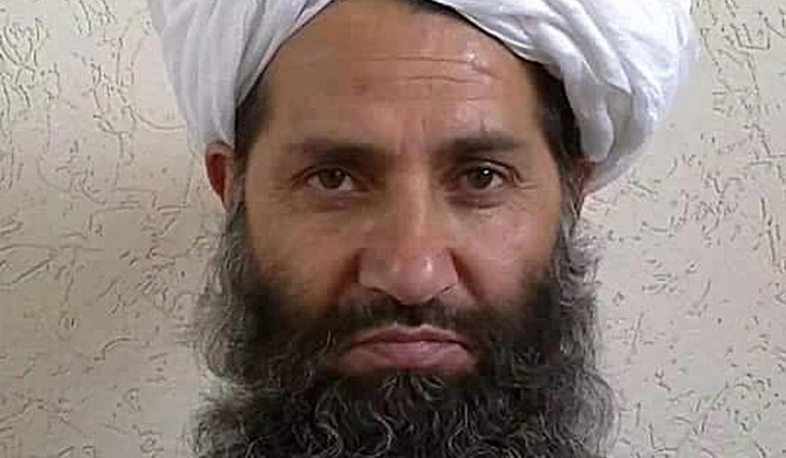In this undated and unknown location photo, the new leader of Taliban fighters, Mullah Haibatullah Akhundzada poses for a portrait. Afghanistan's government has offered the new Taliban leader a choice: make peace or face the same fate as his predecessor, who was killed last week in a U.S. drone strike. (Afghan Islamic Press via AP)