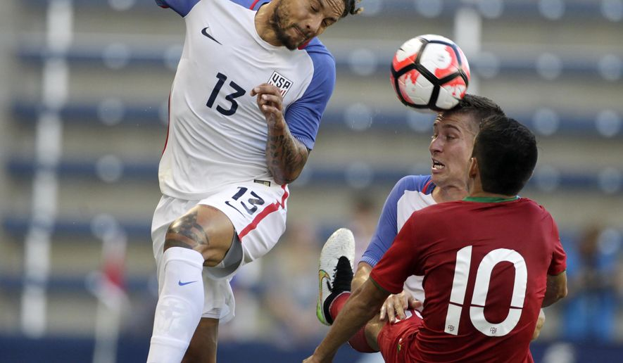U.S. midfielder Jermaine Jones (13) and defender Matt Besler attempt to control the ball against Bolivia midfielder Jhasmani Campos (10) during the first half of an international friendly soccer match, Saturday, May. 28, 2016, in Kansas City, Kan. (AP Photo/Colin E. Braley)